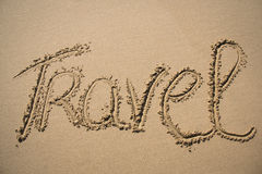 The word travel written in the sand Stock Photography