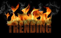 Word Trending in Fire Text. This is the word trending in fire text with billows of smoke rolling off the flame and the word is cracked.  Horizontal on a black Royalty Free Stock Photography