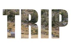 Word TRIP over small brick house on Rocky mountain slope with ra. Re trees. Andorra Royalty Free Stock Image