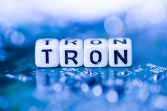 Word TRON formed by alphabet blocks on mother cryptocurrency. Closeup stock photos