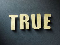 The word True on paper background Stock Image