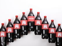 Word `Trump` and Republican Elephants. TEXAS, AUSTIN - DECEMBER 2, 2016: Word `Trump` and Republican Elephants on the bottles isolated on white. The illustration Stock Photos