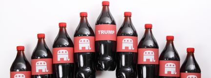 Word `Trump` and Republican Elephants. TEXAS, AUSTIN - DECEMBER 2, 2016: Word `Trump` and Republican Elephants on the bottles isolated on white. The illustration Royalty Free Stock Photography