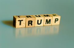 The word trump written in cubes. On blue background stock photos