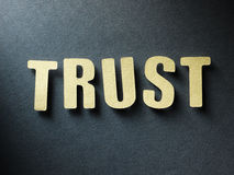 The word Trust on paper background Stock Photos