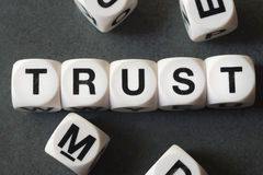 Word trust on toy cubes. Word trust on white toy cubes Royalty Free Stock Image