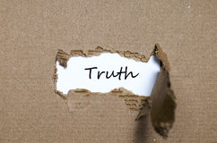 The word truth appearing behind torn paper Royalty Free Stock Photography
