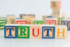 """The word """"truth"""" spelled with wooden letter cubes Stock Photos"""