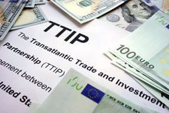 Word TTIP on a paper with dollars. Royalty Free Stock Images