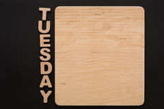 Word Tuesday with blank wooden board Stock Photo
