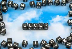 The word Ulcer. On the sky background Royalty Free Stock Photos