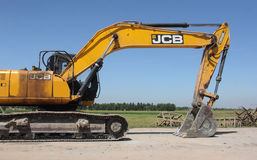 Word under JCB, National Highway No. 64 Stock Image