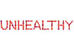 Word UNHEALTHY made of red sugary candies Royalty Free Stock Image