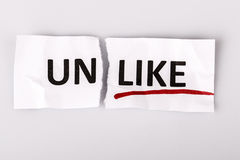 The word unlike changed to like on torn paper Royalty Free Stock Image