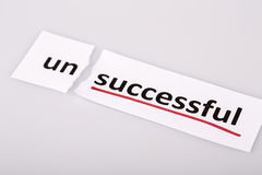 The word unsuccessful changed to successful on torn paper Stock Photography