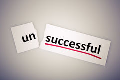 The word unsuccessful changed to successful on torn paper Royalty Free Stock Images