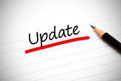The word update written on a notepad. With a pencil and underlined in red Royalty Free Stock Images