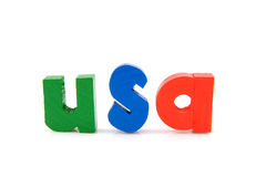 Word USA in wooden letters. Word USA in wooden colorful letters, isolated on white background Stock Images