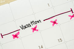 Word vacation is written on a calendar. Royalty Free Stock Photos