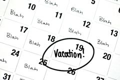 The Word Vacation is Written and Circled on a Calendar Royalty Free Stock Photo