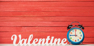 Word Valentine and clock. Royalty Free Stock Photography