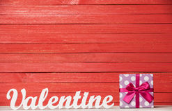 Word Valentine and gift Stock Images