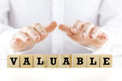 The word - Valuable- on wooden cubes Royalty Free Stock Photos