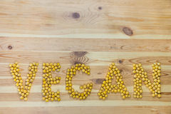 Word Vegan made of chickpeas Royalty Free Stock Images