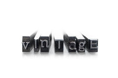 The word Vintage. Done in random letterpress type on a white background Royalty Free Stock Photos