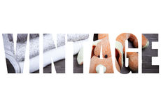 Word VINTAGE over knitted toy dog and stack of knitting clothes Stock Images