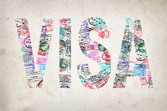 Word visa created with passport stamps Royalty Free Stock Photo