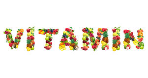 Word VITAMIN composed of different fruits with leaves Royalty Free Stock Image