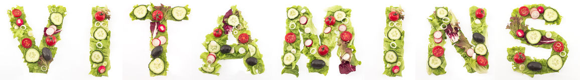 Word vitamins made of salad Royalty Free Stock Images