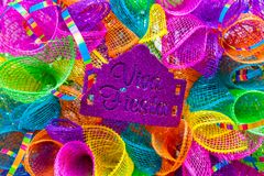 The word `viva fiesta` written in purple glitter on multicolored mash. Decoration for San Antonio Fiesta Festival stock photo