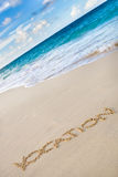 Word Vocation writed on white sand beach Stock Photo