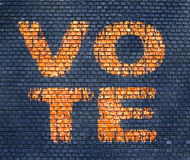 Word Vote on a brick wall Stock Images