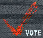 Word Vote on a brick wall Royalty Free Stock Photo