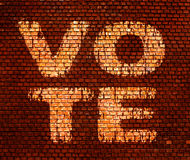 Word Vote on a brick wall Stock Photography