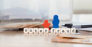 Word VOTER FRAUD composed of wooden letters. Closeup stock photography