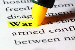 Word war highlighted with a yellow marker. The word war written on paper and highlighted with a yellow marker Royalty Free Stock Photo