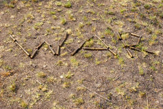 The word 'war' made with shells. On the grass Royalty Free Stock Photos