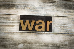 War Letterpress Word on Wooden Background. The word `war` written in wooden letterpress type on a white washed old wooden boards background Royalty Free Stock Photos
