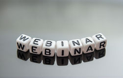 Word webinar from letter cubes on smartphone Stock Photo