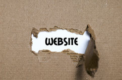 The word website appearing behind torn paper. The word website behind torn paper Stock Image