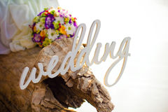 Word wedding, bouquet and rings Stock Photography