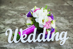 The word Wedding and bridal bouquet Royalty Free Stock Photo