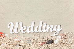 Word Wedding and net with shells Royalty Free Stock Photo