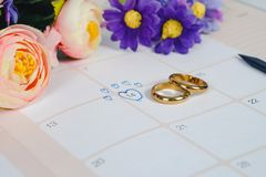 Word Wedding to Reminder Wedding day with Wedding ring on calendar. Planning and office tool royalty free stock images