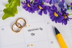 Word Wedding to Reminder Wedding day with Wedding ring on calendar planning. And office tool stock photos
