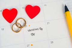 Word Wedding to Reminder Wedding day with Wedding ring on calendar planning. And office tool royalty free stock photography